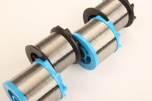 Medical braiding wire on bobbins